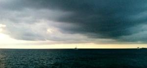 ocean horizon with sailboat