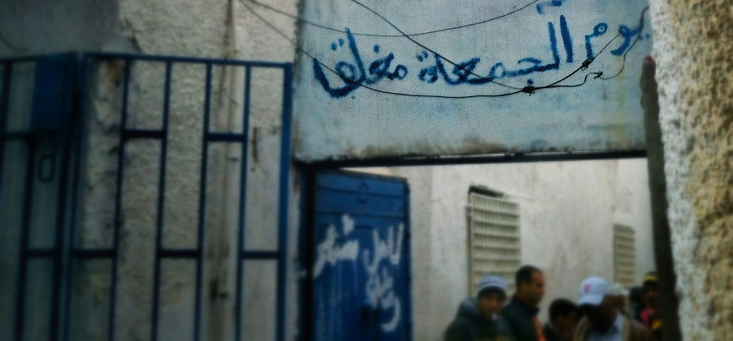 entry sign at rue abdallah guech
